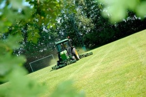 Riding Lawn Mower Cutting a Field